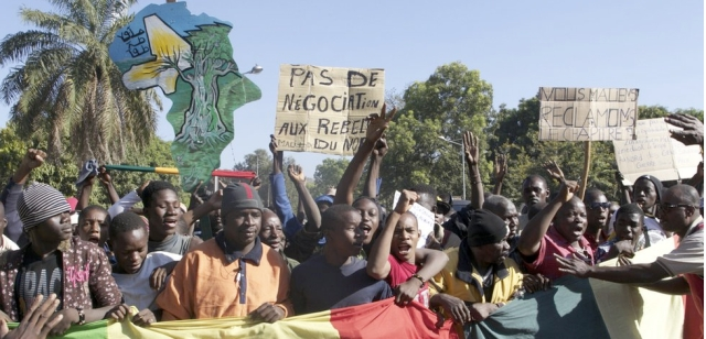 "Demonstrators in Bamako call for UN intervention, Dec. 8; the sign at upper left reads ""Mali cannot be divided."""