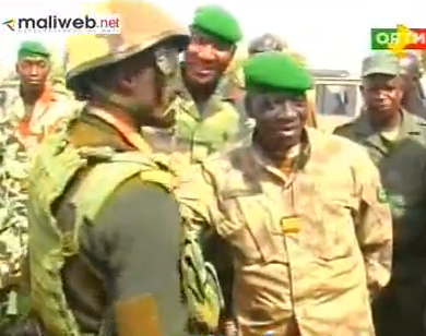 Capt. Amadou Haya Sanogo (right) greets the troops in Sévaré, 12 January