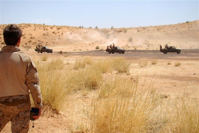 US Navy SEAL instructor observes Malian soldiers in live fire exercise, Gao, 2009