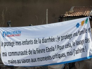 A banner by Mali Health promoting hand washing for the prevention of diarrhea and Ebola